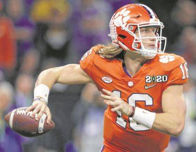Clemson's only loss this season came in double-overtime at Notre Dame without quarterback Trevor Lawrence, pictured, and three defensive starters.