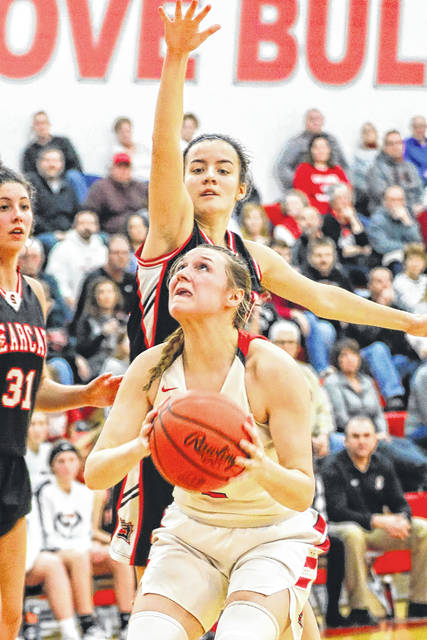 Spencerville's Emma Leis, here defending a shot by Columbus Grove's Angel Schneider, returns after being named first team All-Northwest Conference last season as a junior.