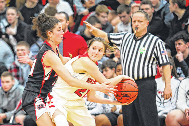 Columbus Grove's Kenzie King, here being defended by Spencerville's Nelaya Burden, returns after being selected first team All-Northwest Conference and Putnam County League last season as a sophomore.