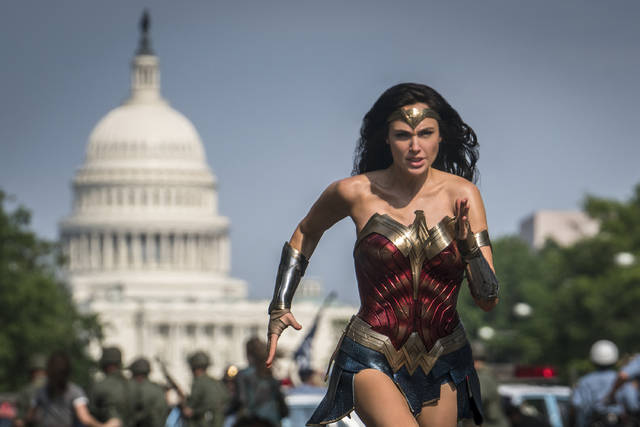 """This image released by Warner Bros. Pictures shows Gal Gadot as Wonder Woman in a scene from """"Wonder Woman 1984."""" Warner Bros. announced it will release all of its 2021 movies simultaneously to HBO Max subscribers and movie theaters."""