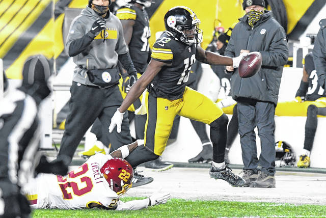 Pittsburgh Steelers wide receiver James Washington (13) gets past Washington Football Team free safety Deshazor Everett (22) after taking a pass from quarterback Ben Roethlisberger for a 50-yard touchdown play during the first half of an NFL football game in Pittsburgh, Monday, Dec. 7, 2020. (AP Photo/Barry Reeger)