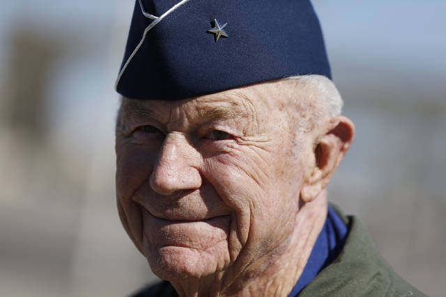 Retired Air Force Brig. Gen. Charles Yeager talks to members of the media Oct. 14, 2012, following a re-enactment flight commemorating his breaking of the sound barrier 65 years earlier, at Nellis Air Force Base, Nev. Yeager died Monday.