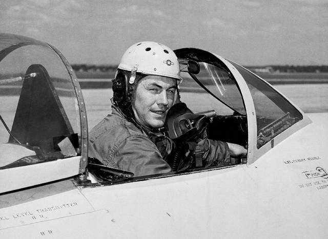 In this 1948 file photo, test pilot Charles E. Yeager, 25, poses for a picture in a jet's cockpit. Yeager was the first to fly faster than the speed of sound. Yeager also flew a jet under a Charleston, W.Va., bridge in 1948.