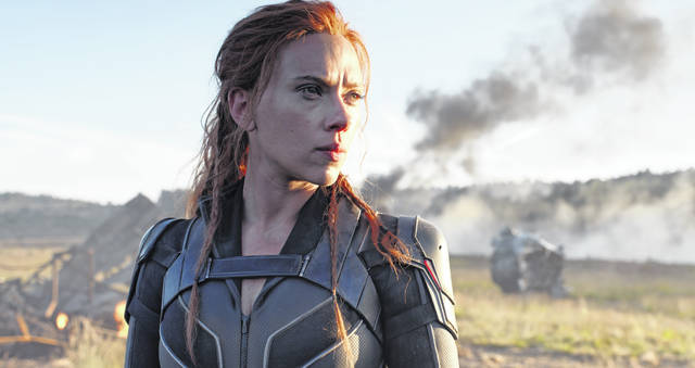 """This image released by Disney/Marvel Studios' shows Scarlett Johansson in a scene from """"Black Widow."""" The movie will still open at theaters first, although much of Disney's planned content with debut on its streaming service, Disney+."""