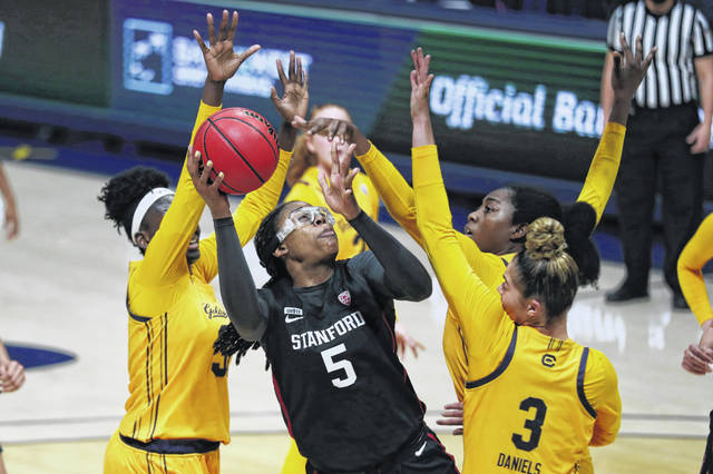 Stanford's Francesca Belibi (5) drives against California's Fatou Samb (33) and Dalayah Daniels (3) during the first half of an NCAA college basketball game Sunday, Dec. 13, 2020, in Berkeley, Calif. (AP Photo/Jed Jacobsohn)