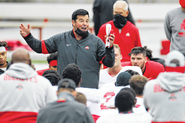 In this Saturday, Oct. 3, file photo, Ohio State head coach Ryan Day talks to his team during their NCAA college football practice, in Columbus, Ohio. As Alabama, Ohio State, Clemson, Oregon, Notre Dame, Oklahoma and Florida prepared to play for conference championships, they signed top-10 recruiting classes for 2021 they hope to fuel their next title contenders.