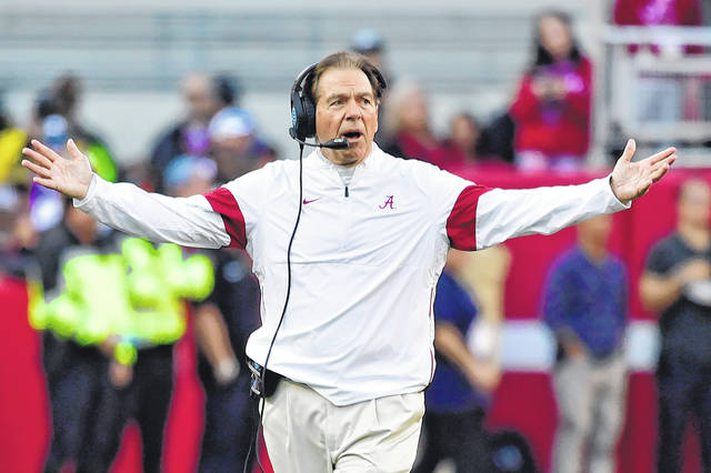 In this Nov. 9, 2019, file photo, Alabama coach Nick Saban reacts during the first half of the team's NCAA college football game against LSU in Tuscaloosa, Ala. As Alabama, Ohio State, Clemson, Oregon, Notre Dame, Oklahoma and Florida prepared to play for conference championships, they signed top-10 recruiting classes for 2021 they hope to fuel their next title contenders.