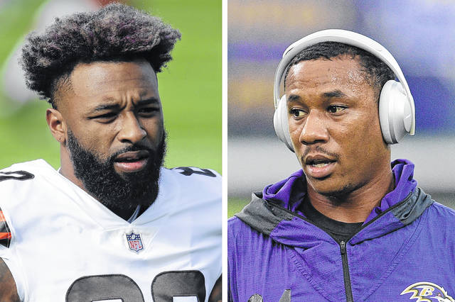 """At left in a Dec. 6, 2020, photo, Cleveland Browns wide receiver Jarvis Landry warms up before an NFL football game against the Tennessee Titans in Nashville, Tenn. At right in a Sept. 28, 2020, photo, Baltimore Ravens cornerback Marcus Peters warms up before an NFL football game against the Kansas City Chiefs in Baltimore. Browns wide receiver Jarvis Landry called Ravens cornerback Marcus Peters """"a coward"""" for appearing to spit at him during Monday night's, Dec. 14 game. A video taken from the national TV broadcast shows Peters spitting in Landry's direction at the end of the first quarter. (AP Photo)"""