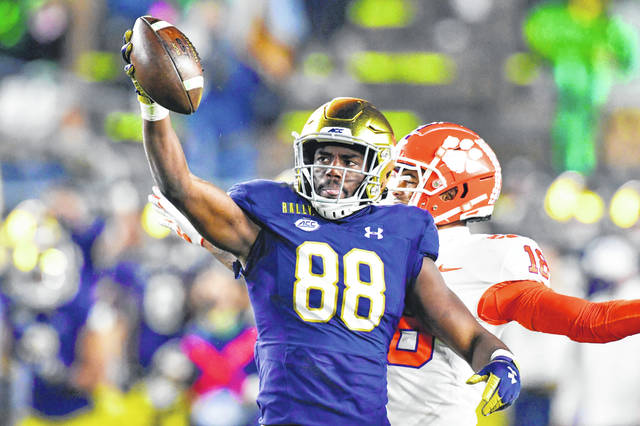 FILE - Notre Dame wide receiver Javon McKinley (88) reacts after a catch during the third quarter against Clemson in an NCAA college football game in South Bend, Ind., in this Saturday, Nov. 7, 2020, file photo. The Notre Dame Fighting Irish beat the Clemson Tigers in a thrilling 47-40 shootout earlier this season. The big question now is if they can do it again. (Matt Cashore/Pool Photo via AP, File)