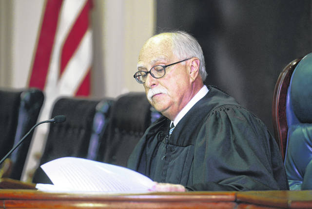 Muskingum County Common Pleas Judge Mark C. Fleegle reads during a court proceeding in Zanesville in 2016. Fleegle, who failed to adopt written rules for mask wearing and other coronavirus prevention measures, has been barred from overseeing two upcoming trials. His lack of written procedures makes it difficult for jurors and others to know what's expected of them, Ohio Supreme Court Chief Justice Maureen O'Connor said in an order.