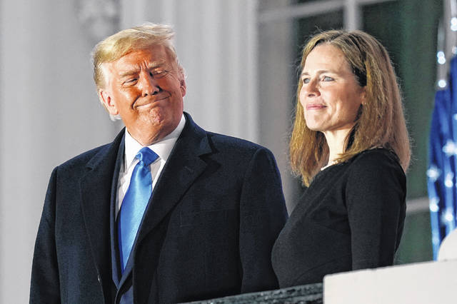 President Donald Trump and Amy Coney Barrett stand on the Blue Room Balcony after Supreme Court Justice Clarence Thomas administered the Constitutional Oath to her Oct. 26 on the South Lawn of the White House. President Donald Trump left a deep imprint on the federal courts.