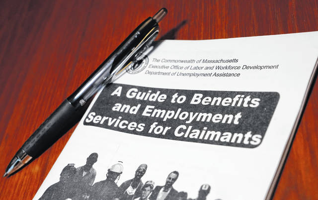 "A booklet describing unemployment benefits is seen Nov. 5 in North Andover, Mass. Unemployment insurance aid is expiring for millions on the weekend as President Donald Trump griped about ""pork"" in the bipartisan legislation passed by Congress."