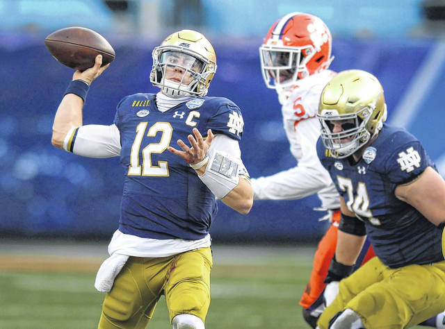 FILE - In this Saturday, Dec. 19, 2020, file photo, Notre Dame quarterback Ian Book throws a pass against Clemson during the Atlantic Coast Conference championship NCAA college football game in Charlotte, N.C. (Jeff Siner/The News & Observer via AP, File)