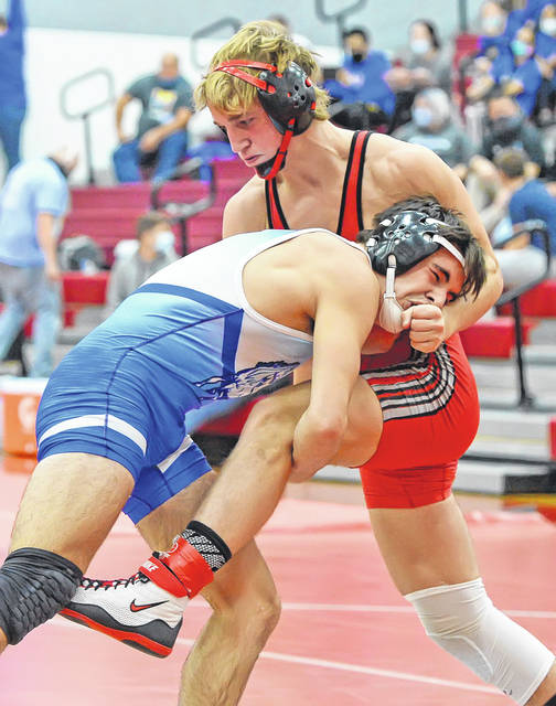 Allen East's Kade Wireman, left, competes against Lima Senior's Aaron Bowsher during Saturday's Allen County Tournament at Lima Senior High School.