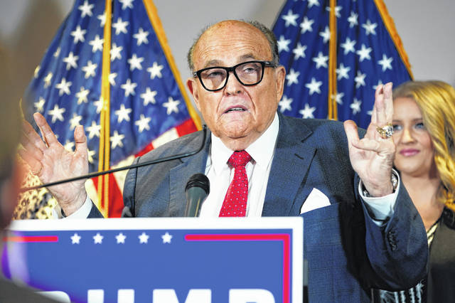 "FILE - In this Nov. 19, 2020, file photo, former New York Mayor Rudy Giuliani, a lawyer for President Donald Trump, speaks during a news conference at the Republican National Committee headquarters, in Washington. Giuliani urged Michigan Republican activists on Wednesday, Nov. 2, 2020, to pressure the GOP-controlled Legislature to ""step up"" and award the state's 16 electoral votes to Trump despite Democrat Joe Biden's 154,000-vote victory."