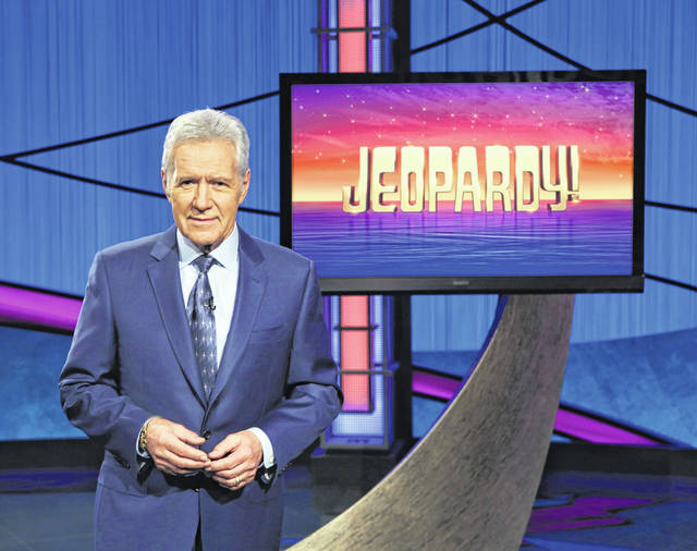 """This image released by Jeopardy! shows Alex Trebek, host of the game show """"Jeopardy!"""" Trebek's memoir, """"The Answer Is…: Reflections on My Life,"""" will be released July 21. Trebek made no secret of the fight with pancreatic cancer that claimed his life on Nov. 8. If there was any good to come of it, he inspired others and learned how much he was appreciated and loved."""