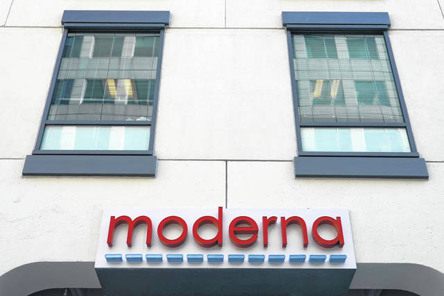 FILE - In this Dec. 15, 2020, file photo, a sign for Moderna, Inc. hangs on its headquarters in Cambridge, Mass. The U.S. is poised to give the green light as early as Friday, Dec. 18, to a second COVID-19 vaccine, a critical new weapon against the surging coronavirus. Doses of the vaccine developed by Moderna Inc. and the National Institutes of Health will give a much-needed boost to supplies as the biggest vaccination effort in the nation's history continues.