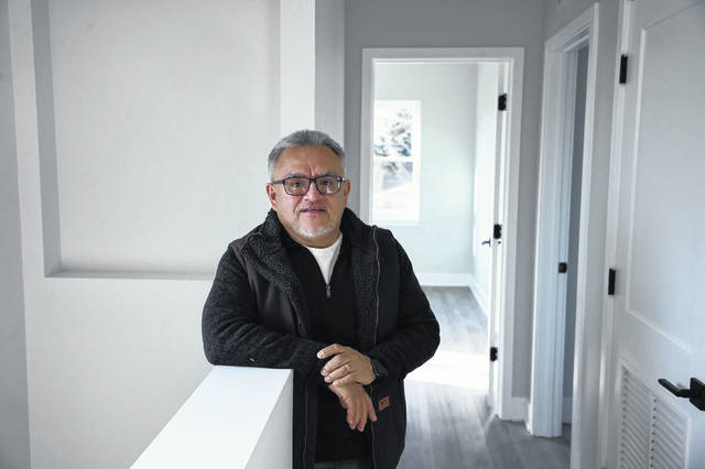 Raul Raymundo, CEO of The Resurrection Project, is seen inside a home newly constructed by the organization on South Ada Street in Chicago on Nov. 18.