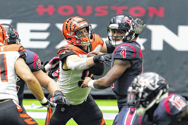 Houston Texans quarterback Deshaun Watson (4) fumbles the football as he is hit by Cincinnati Bengals defensive end Sam Hubbard (94) during the Bengals' 37-31 win on Sunday in Houston. Cincinnati recovered the fumble.