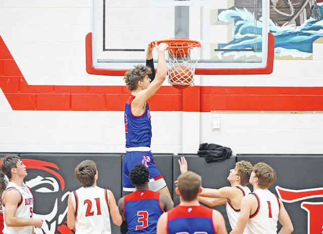 Crestview's Kalen Etzler, who finished with 14 points, dunks against Bluffton during Monday's game at Bluffton High School.
