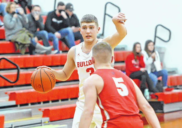 Columbus Grove's Tayt Birnesser calls out a play while being defended by Van Wert's Owen Treece during Monday night's game at Columbus Grove. Grove won 65-61 in overtime. No other information was reported about the game at deadline.