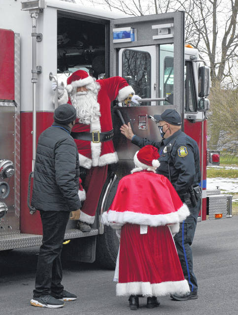 Santa and Mrs. Claus helped deliver presents to children Saturday through the Cops and Kids program.