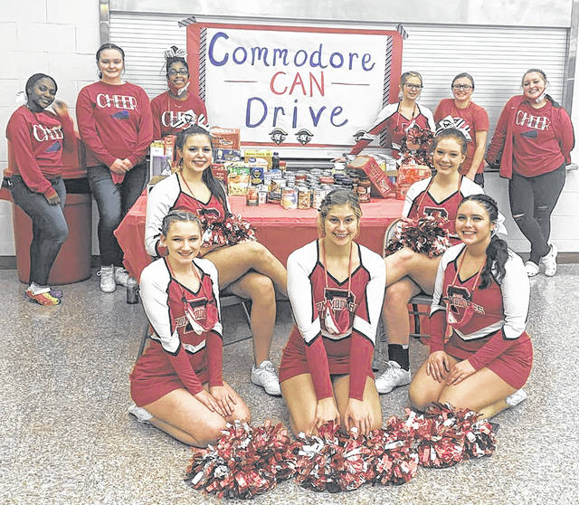 Cheerleaders from Perry High School raised around $1,600 to help a local family out this Christmas.