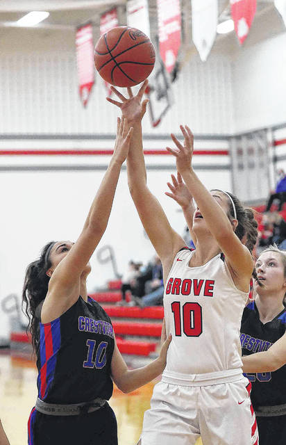 Columbus Grove's Erin Downing puts up a shot against Crestview's Laci McCoy during Thursday night's game at Columbus Grove.