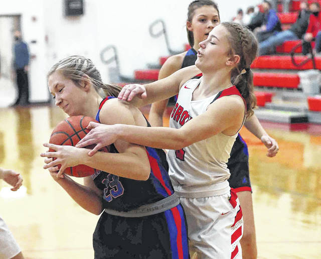 Crestview's Olivia Cunningham, left, tries to keep Columbus Grove's Jaylen Sautter from forcing a jump ball during Thursday night's game at Columbus Grove. Head to 3C and LimaScores.com to see more game photos.