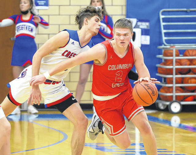 Columbus Grove's Blake Reynolds drives against Crestview's Kalen Etzler during Friday night's game at Crestview. See more game photos at LimaScores.com.