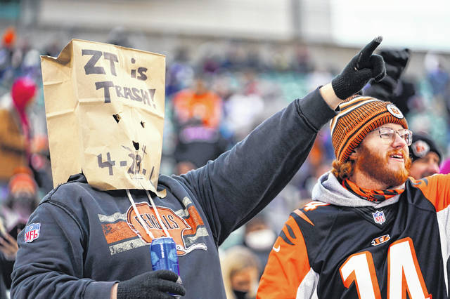 A Cincinnati Bengals fan expresses his opinion of the Bengals' performance and of coach Zac Taylor during a 30-7 loss to the Dallas Cowboys on Sunday in Paul Brown Stadium.