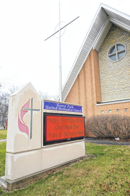 A sign at Forest Park United Methodist Church at 315 S Collins displays different times of services during the coronavirus crisis on Wednesday.  Richard Parrish | The Lima News