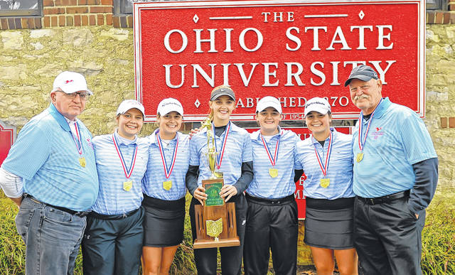 Lima Central Catholic made school and state history by winning the Division II state golf tournament for the third straight season. The Thunderbirds became the first Division II girls golf team to win three consecutive titles. Pictured here from left: Assistant Coach Pete Hubbell, Carlie VanMeter, Erin Mulcahy, Emma Mayers, Bridget Mulcahy, Mary Kelly Mulcahy, and Head Coach Daniel Reinicke .