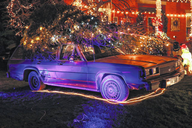 """A station wagon with a Christmas tree tied is in honor of Clark Griswold, who said: """"We're kicking off our fun, old-fashioned family Christmas by heading out into the country in the old front-wheel drive sleigh to embrace the frosty majesty of the winter landscape and select that most important of Christmas symbols."""""""