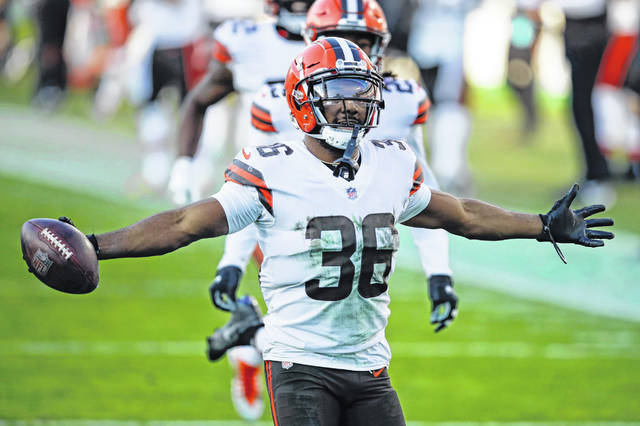 Cleveland Browns cornerback M.J. Stewart (36) celebrates after intercepting a pass against the Tennessee Titans in the second half of the Browns' 41-35 win over the Titans in Nashville.