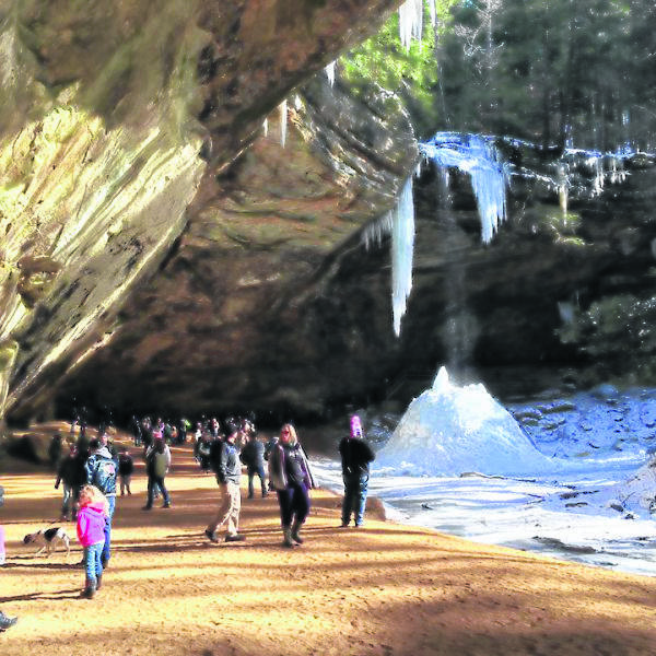 Participants enjoy a winter hike at Hocking Hills in 2018. In-person guided hikes are on hold.
