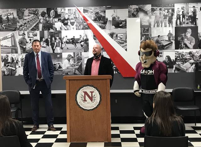 Ohio Means Jobs-Allen County Director Joe Patton, left, and Tim Fitzpatrick, dean of the Colleges of Business, Health Professions and Occupational Professions for UNOH, unveiled a new partnership Tuesday between the university and OMJ to connect students with employers.