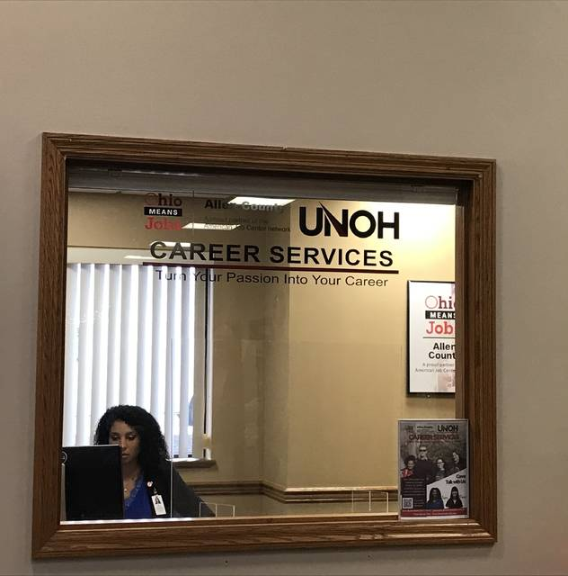 Samantha Butterfield, a career coach for Ohio Means Jobs-Allen County, sits in the new career services office on the UNOH campus off Cable Road.