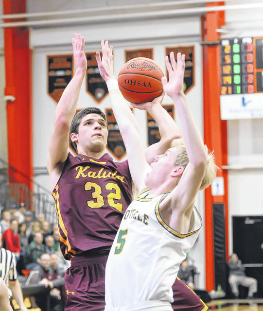 Kalida's Luke Erhart, here putting up a shot against Ottoville's Ryan Suever, was named first team All-Putnam County Conference as a junior.