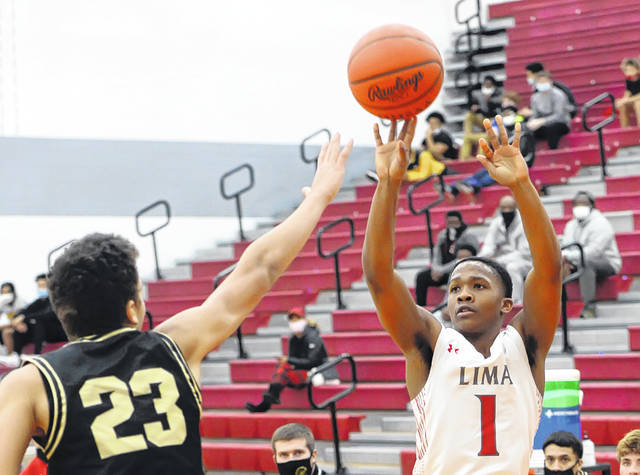 Lima Senior's Khalil Luster puts up a shot against Perrysburg's Matt Watkins during Tuesday night's game at Lima Senior High School. See more game photos at LimaScores.com.