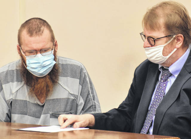 Matthew Smith, left, confers with his attorney, Steve Chamberlain, after signing a waiver of his constitutional right to a speedy trial. Smith is charged with 83 felony counts that include rape and gross sexual imposition.