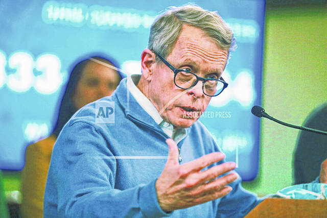 FILE - In this March 14, 2020, file photo, Ohio Gov. Mike DeWine speaks at a coronavirus news conference at the Ohio Statehouse in Columbus, Ohio. DeWine disregarded warnings from consumer and environmental advocates and a last-minute plea from Republican insiders in selecting the powerful top Ohio utility regulator now under legal and financial scrutiny, Samuel Randazzo. (Doral Chenoweth/The Columbus Dispatch via AP, File)