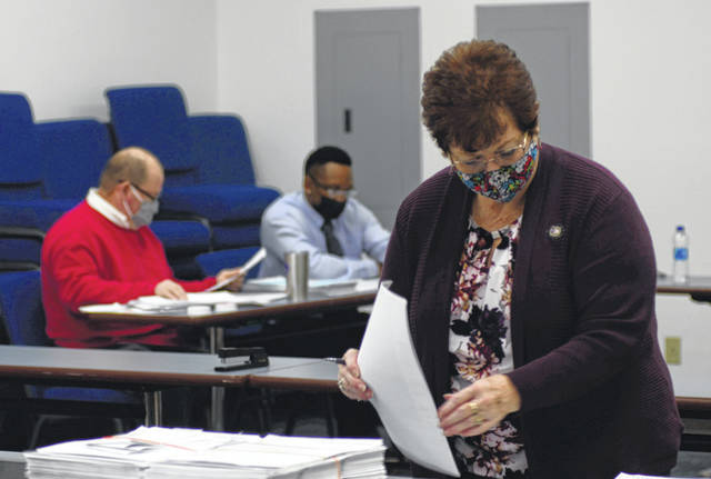 Allen County Board of Election Director Kathy Meyer helps election workers conduct the post-election audit to double check the absence of errors.