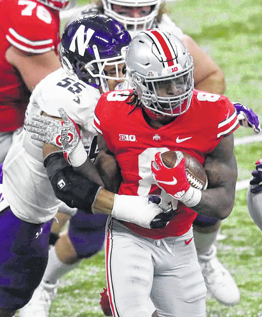 Ohio State's Trey Sermon tries to get away from Northwestern's Eku Leota during Saturday's Big Ten championship game at Lucas Oil Stadium in Indianapolis.
