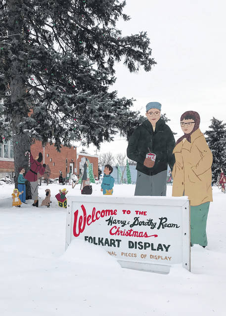 A cutout of the Reams is included in the display. The couple started making and painting lighted cutouts for their yard in 1938, thrilled by electricity coming to the farm the year before.