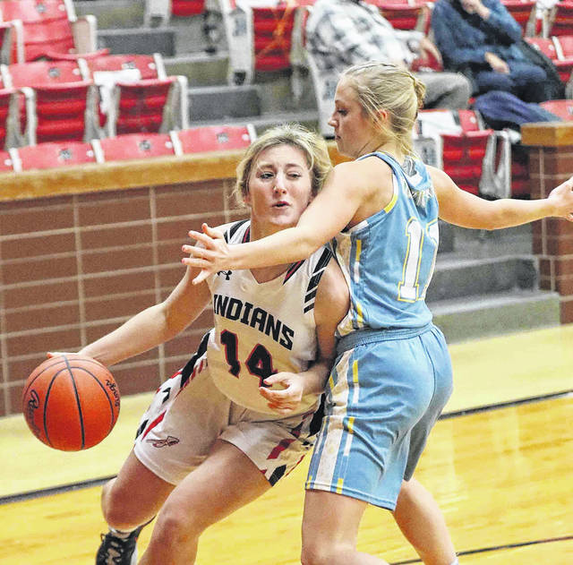 Shawnee's Grace Freiberger drives to the basket against Bath's Alexandria Renner in the first quarter at Shawnee High School Thursday. More photos are available at limanews.com.