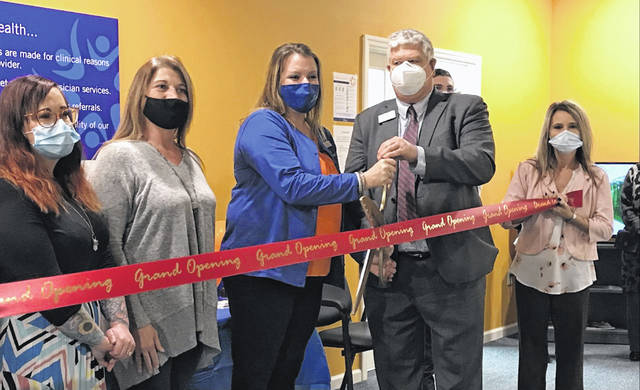 Amber Newcomer, third from left, and Spero Health associates were joined by Jed Metzger, second from right, for a ribbon cutting ceremony at the outpatient clinic on Tuesday. The clinic is located in the strip mall next to H&R Block and Walgreens at the corner of Cable and Allentown Road.