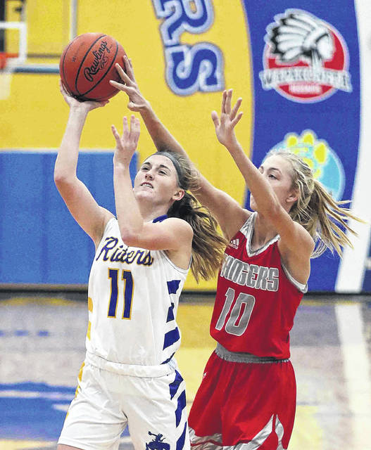 St. Marys' Kendall Dieringer puts up a shot against New Knoxville's Carsyn Henschen during Saturday's game at St. Marys.