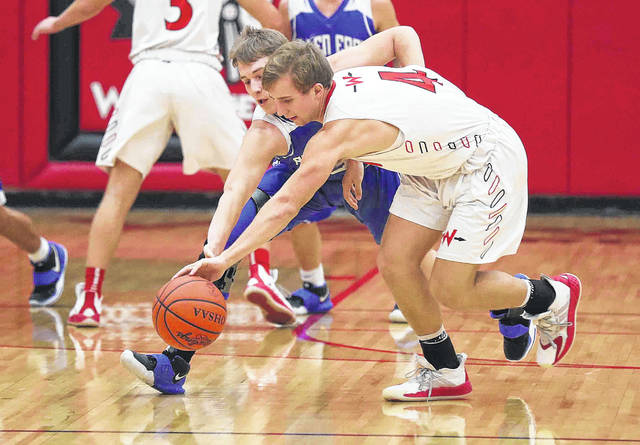Allen East's Tyler Clum, left, tries to make the steal against Wapakoneta's Kaiden Siefring (4) during Tuesday night's game at Wapakoneta. See more game photos at LimaScores.com.
