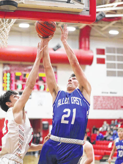 Allen East's Gabe Criblez puts up a shot against Wapakoneta's John Buchanan during Tuesday night's game at Wapakoneta.